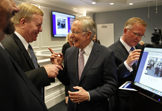 Sen. Harry Reid, D-Nev., laughs as he speaks with Nevada Supreme Court Chief Justice Mark Gibbons, left, during Wednesday's grand opening of the Robert T. Eglet Advocacy Center. Robert Eglet, at ...