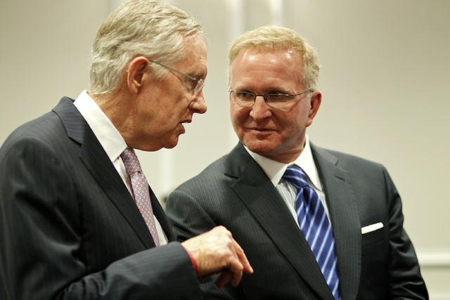 Sen. Harry Reid, D-Nev., left, speaks with Robert Eglet during an event to open the Robert T. Eglet Advocacy Center in Las Vegas Wednesday, March 19, 2014. (John Locher/Las Vegas Review-Journal)