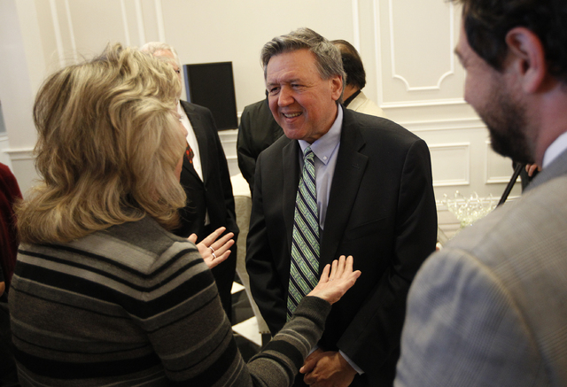 David Thomas speaks with Rep. Dina Titus, left, during an event to open the Robert T. Eglet Advocacy Center in Las Vegas Wednesday, March 19, 2014. (John Locher/Las Vegas Review-Journal)