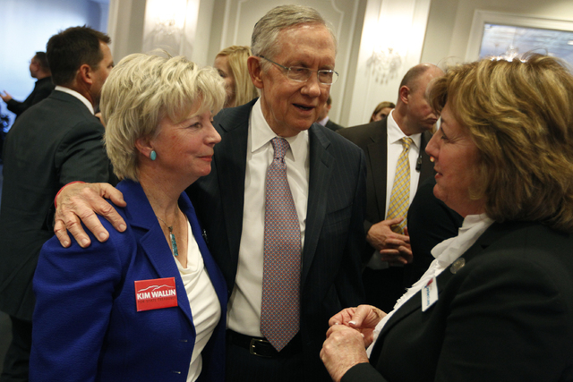 Sen. Harry Reid, D-Nev., center, speaks with Nevada Assemblywoman Marilyn Dondero Loop, right, and Nevada Controller Kim Wallin, left, during an event to open the Robert T. Eglet Advocacy Center i ...