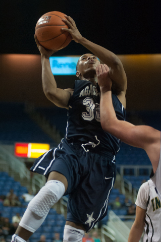 Agassi Prep's Kenneth Katano (32) attempts a shot against Incline during the Division III state final on Saturday. Hatano had 20 points and 10 rebounds as Agassi defeated Incline 71-60. (Kevin Cli ...