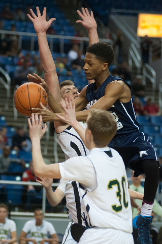Agassi Prep's Kobe Williams (12) tries to shoot between Incline's Ben Snyder (55) and Dylan Comstock (30) during the Division III state final on Saturday. Williams had 12 points as Agassi defeated ...