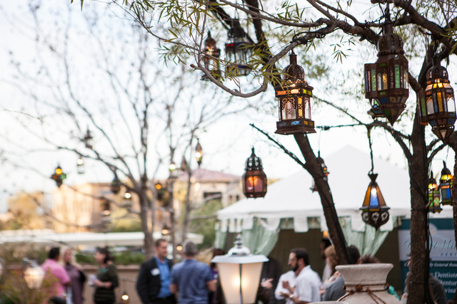 People mingle during a company event in the outdoor area at Vintner Grill, 10100 W. Charleston Blvd., in the Summerlin on Thursday. (Chase Stevens/Las Vegas Review-Journal)