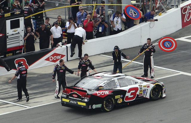 Crew members greet Austin Dillon as he drives down pit road before the start of the NASCAR Daytona 500 Sprint Cup series auto race at Daytona International Speedway in Daytona Beach, Fla., Sunday, ...