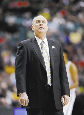 UCLA coach Ben Howland checks the clock against Oregon in the first half of the Pac-12 tournament championship NCAA college basketball game, Saturday, March 16, 2013, in Las Vegas. (AP Photo/Julie ...