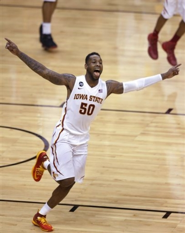 Iowa State guard DeAndre Kane (50) celebrates after the Cyclones won the Big 12 Conference men's tournament in Kansas City, Mo. Iowa State defeated Baylor 74-65. (AP Photo/Orlin Wagner)