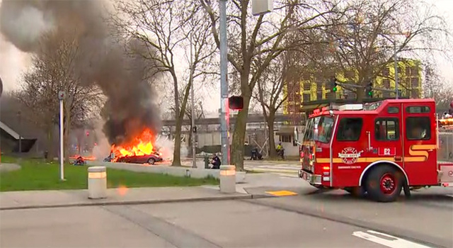 Smoke rises from the scene of a news helicopter crash outside the KOMO-TV studios near the Space Needle in Seattle on Tuesday. The station says the copter was apparently lifting off from its rooft ...