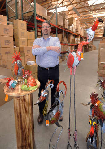 Frank Schleidt stands behind some of the Bali Garden lawn and garden ornaments at the G.W. Schleidt warehouse on Wednesday. The ornaments will be on display at the ASD Las Vegas Trade Show startin ...