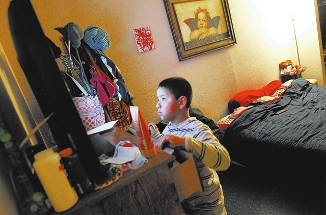 6-year-old Anthony Ruiz, who suffers from autism, watches  television from close range in his parents room at his home in Las Vegas on Thursday, Feb. 27, 2014. Ruiz has been on a waiting list for  ...
