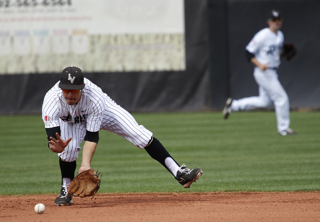 UNLV shortstop Matt McCallister makes a play in the field while taking on Air Force during their baseball game at Wilson Stadium in Las Vegas on March 1, 2014. (Jason Bean/Las Vegas Review-Journal)