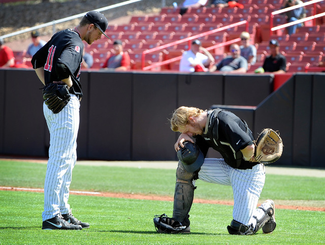 UNLV catcher Erik Vanmeetren, right, takes a moment in the heat as pitcher Bryan Bonnell looks on during a NCAA baseball game against San Diego State at Wilson Stadium on Sunday, March 23, 2014. ( ...