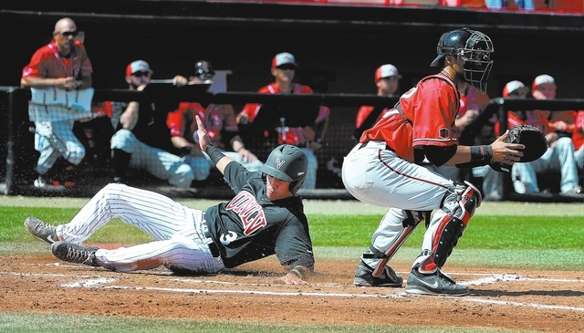 UNLV's Joey Armstrong (3) slides safely by San Diego State's Brad Haynal to score UNLV's first run during a NCAA baseball game at Wilson Stadium on Sunday, March 23, 2014. (David Becker/Las Vegas  ...