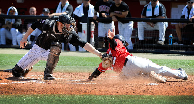 UNLV catcher Erik Vanmeetren, left, tags out San Diego State's Tim Zier at home plate during a NCAA baseball game against San Diego State at Wilson Stadium on Sunday, March 23, 2014. (David Becker ...
