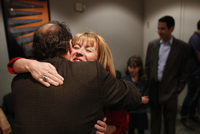 Democrat Erin Bilbray hugs Clark County Democratic Party Chairman Chris Miller before she files paperwork to run for Congress against U.S. Rep. Joe Heck, R-Nev., at the Clark County Government Cen ...