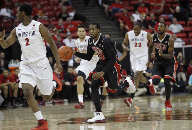 UNLV's Deville Smith (33) leads a fast break against San Diego State during their Mountain West basketball tournament semi-final game at the Thomas & Mack Center in Las Vegas on March 14, 2014. (J ...
