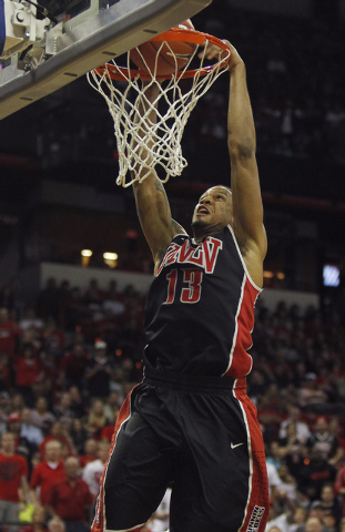 UNLV's Bryce Dejean-Jones dunks against San Diego State during their Mountain West basketball tournament semi-final game at the Thomas & Mack Center in Las Vegas on March 14, 2014. (Jason Bean/Las ...