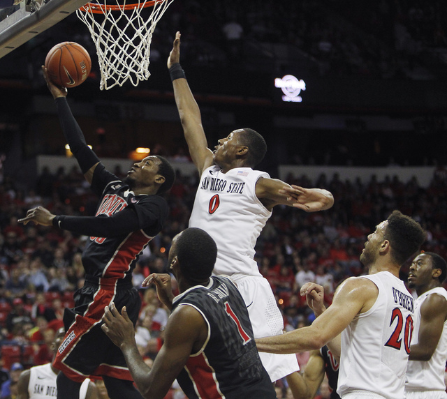 UNLV's Deville Smith (33) shoots past San Diego State's Skylar Spencer (0) during their Mountain West basketball tournament semi-final game at the Thomas & Mack Center in Las Vegas on March 14, 20 ...