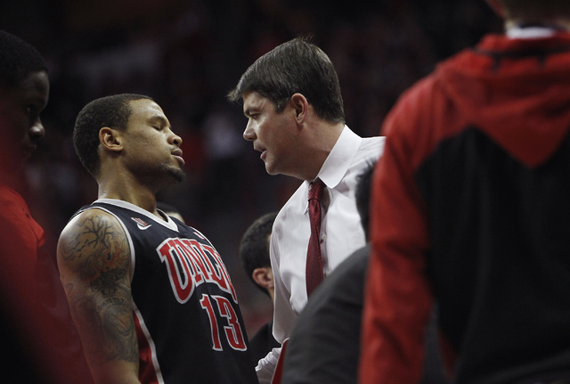 UNLV head coach Dave Rice, right, talks with Bryce Dejean-Jones (13) during a time out against San Diego State during their Mountain West basketball tournament semi-final game at the Thomas & Mack ...