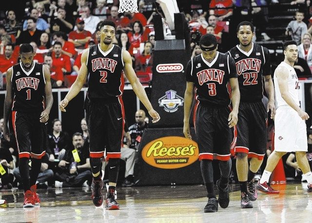 A dejected UNLV team heads to the bench for a time out while taking on San Diego State during their Mountain West basketball tournament semi-final game at the Thomas & Mack Center in Las Vegas on  ...