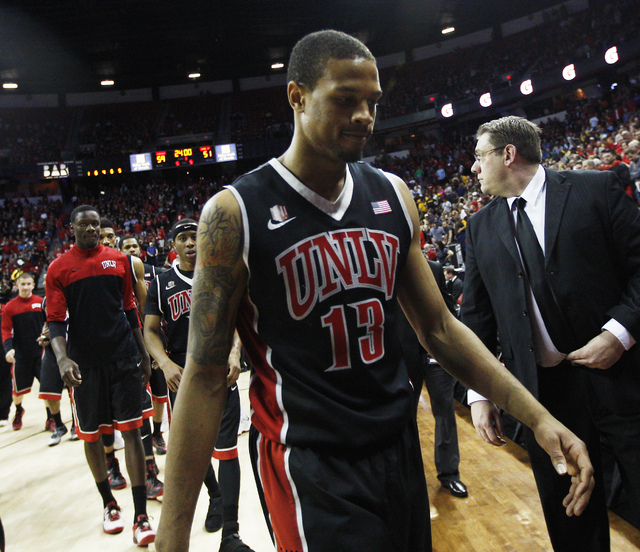 UNLV's Bryce Dejean-Jones (13) heads off the court after losing to San Diego State 59-51 during their Mountain West basketball tournament semi-final game at the Thomas & Mack Center in Las Vegas o ...