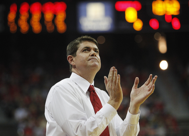 UNLV head coach Dave Rice cheers on his team's effort while taking on Illinois at the Thomas & Mack Center in Las Vegas on Nov. 26, 2013. Rice turned down an offer from the University of South Flo ...