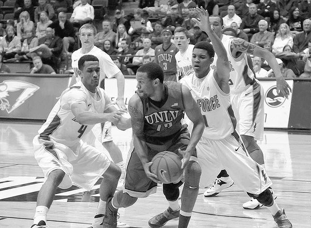 March 1, 2014 - Colorado Springs, Colorado, U.S. - UNLV guard, Bryce Dejean-Jones #13, looks for help during Mountain West Conference action between the UNLV Runnin' Rebels and the Air Force Acade ...