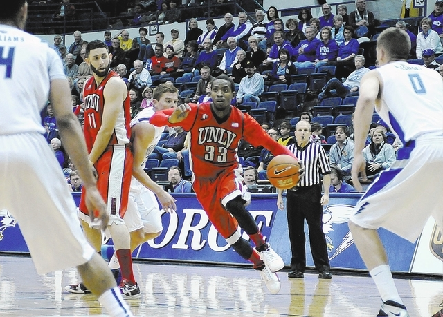 March 1, 2014 - Colorado Springs, Colorado, U.S. - UNLV guard, Deville Smith #33, drives the lane during Mountain West Conference action between the UNLV Runnin' Rebels and the Air Force Academy F ...