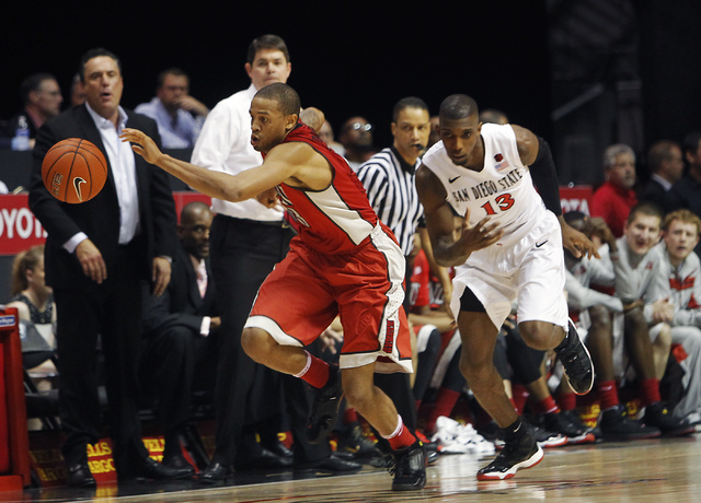 UNLV's Bryce Dejean-Jones (13) leads the break after stealing the ball from SDSU's Winston Shepard (13) during their basketball game at Viejas Arena in San Diego on Saturday, Jan. 18, 2014. (Jason ...