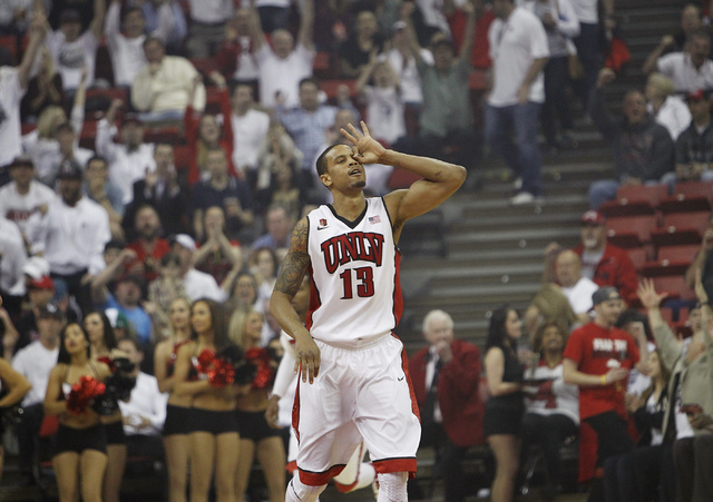 UNLV's Bryce Dejean-Jones celebrates after hitting a three-point shot against San Diego State Wednesday night at the Thomas & Mack Center. Tenth-ranked San Diego State won, 73-64. (Jason Bean/Las  ...