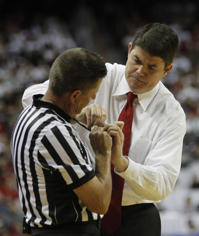 UNLV head coach Dave Rice helps the official with his whistle while taking on San Diego State during their basketball game at the Thomas & Mack Center in Las Vegas on Wednesday, March 5, 2014. (Ja ...