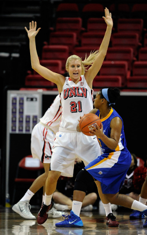 UNLV's Amanda Anderson (21) defends against San Jose State's Classye James during the first half of an NCAA college basketball game in the Mountain West Conference women's tournament Monday, March ...