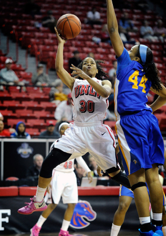 UNLV's Mia Bell (30) shoots against San Jose State's Riana Byrd during the first half of an NCAA college basketball game in the Mountain West Conference women's tournament Monday, March 10, 2014.  ...