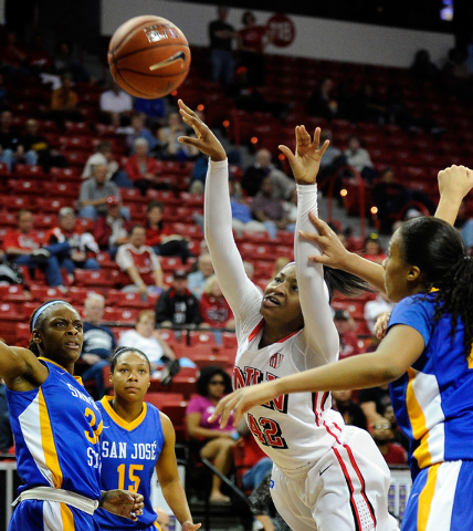 UNLV's Danielle Miller (42) looses the ball as she attempts a shot against San Jose State's Ta'Rea Cunnigan (34), Classye James (15) and Riana Byrd during the second half of an NCAA college basket ...