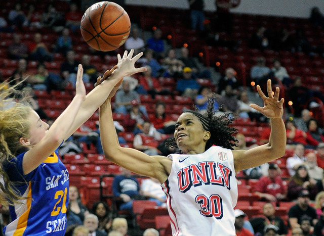 UNLV's Mia Bell (30) and San Jose State's Britta Hall (21) vie for a rebound during the second half of an NCAA college basketball game in the Mountain West Conference women's tournament at the Tho ...