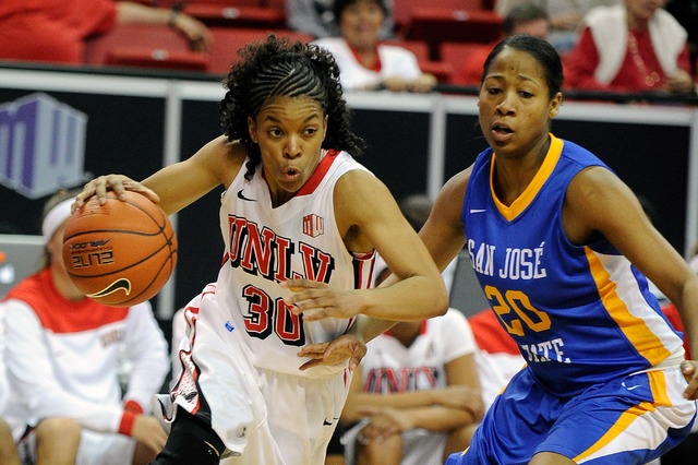 UNLV's Mia Bell (30) drives to the basket against San Jose State's Rachol West during the second half of an NCAA college basketball game in the Mountain West Conference women's tournament at the T ...