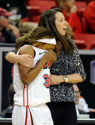 UNLV's Briana Charles is comforted by UNLV coach Kathy Olivier during the second half of an NCAA college basketball game in the Mountain West Conference women's tournament at the Thomas & Mack Cen ...