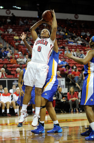UNLV's Amie Callaway (0) shoots against San Jose State during the second half of an NCAA college basketball game in the Mountain West Conference women's tournament Monday, March 10, 2014. UNLV won ...