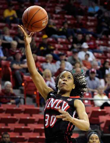 UNLV's Mia Bell (30) shoots against Fresno State during the first half of an NCAA college basketball game in the Mountain West Conference women's tournament at the Thomas & Mack Center on Tuesday, ...