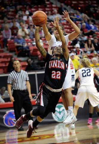 UNLV's Rmanii Haynes (22) shoots against Fresno State's Brittany Aikens during the first half of an NCAA college basketball game in the Mountain West Conference women's tournament at the Thomas &  ...