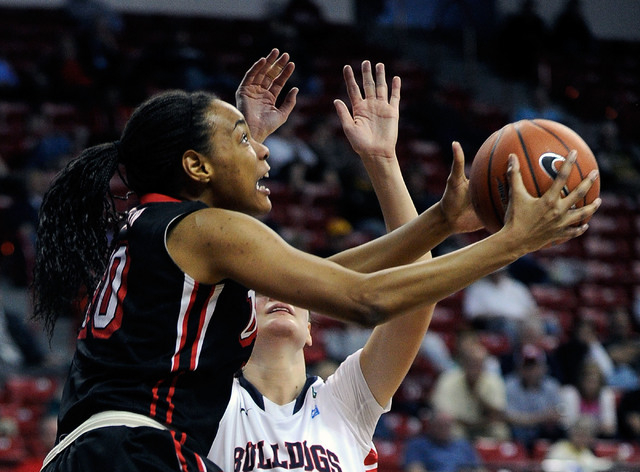 UNLV's Rejane Verin (10) shoots against Fresno State's Jacinta Vandenberg during the first half of an NCAA college basketball game in the Mountain West Conference women's tournament at the Thomas  ...
