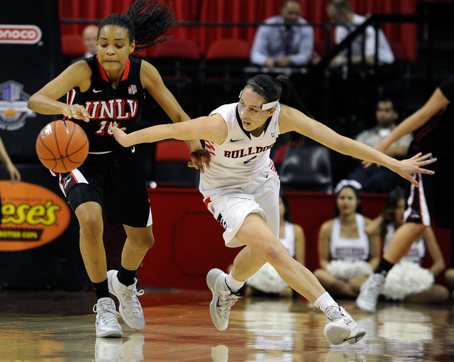 UNLV's Rejane Verin (10) and Fresno State's Bree Farley chase a loose ball during the second half of an NCAA college basketball game in the Mountain West Conference women's tournament at the Thoma ...