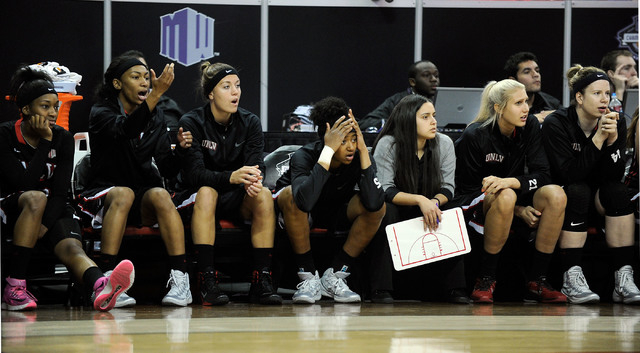 UNLV players watch the action during the second half of an NCAA college basketball game against Fresno State in the Mountain West Conference women's tournament at the Thomas & Mack Center on Tuesd ...