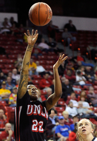UNLV's Rmanii Haynes (22) shoots against Fresno State's Alex Furr during the second half of an NCAA college basketball game in the Mountain West Conference women's tournament at the Thomas & Mack  ...
