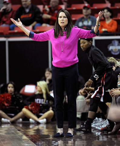 UNLV coach Kathy Olivier calls to her team during the first half of an NCAA college basketball game against Fresno State in the Mountain West Conference women's tournament at the Thomas & Mack Cen ...