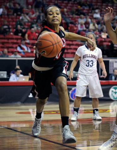 UNLV's Rejane Verin chases the ball along the baseline during the first half of an NCAA college basketball game against Fresno State in the Mountain West Conference women's tournament at the Thoma ...