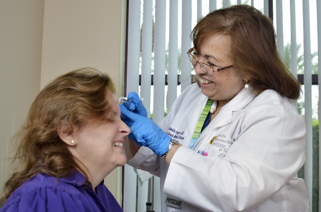 Dr. M. Gabriela Gregory, right, injects patient Nancy Buckley with Botox to help treat Buckley's migraine headaches at the Nevada Neurosciences Institute at 3131 La Canada St. in Las Vegas on Thur ...