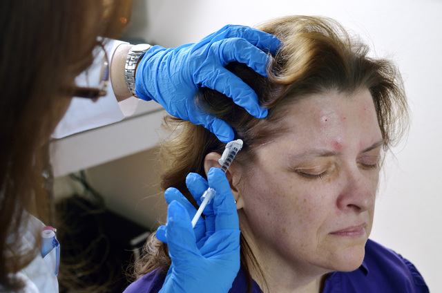 Dr. M. Gabriela Gregory, left, injects patient Nancy Buckley with Botox to help treat Buckley's migraine headaches at the Nevada Neurosciences Institute at 3131 La Canada St. in Las Vegas on Thurs ...