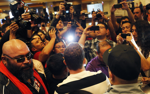 Boxer Canelo Alvarez greets his fans after arriving at the MGM Grand prior to his junior middleweight fight against Alfredo Angulo in Las Vegas on Tuesday, March 4, 2014. (Jason Bean/Las Vegas Rev ...