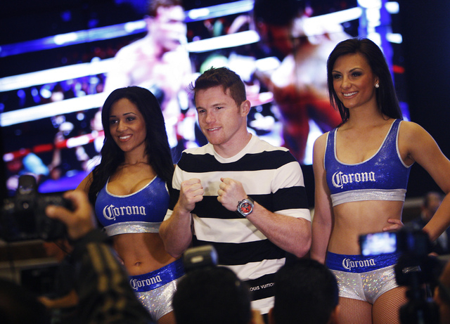 Boxer Canelo Alvarez poses for photos after arriving at the MGM Grand prior to his junior middleweight fight against Alfredo Angulo in Las Vegas on Tuesday, March 4, 2014. (Jason Bean/Las Vegas Re ...