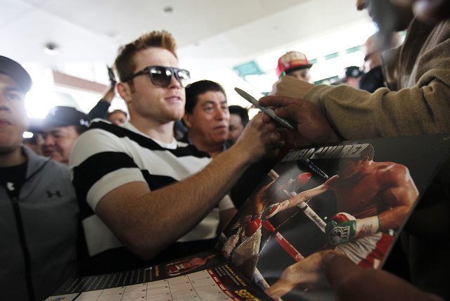 Boxer Canelo Alvarez signs autographs while arriving at the MGM Grand prior to his junior middleweight fight against Alfredo Angulo in Las Vegas on Tuesday, March 4, 2014. (Jason Bean/Las Vegas Re ...